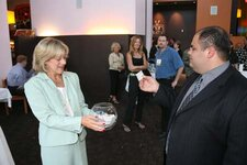 Kim Jednachowski, GCI, and Anthony DiMaio, Cameo Metal Products (event sponsor), draw the raffle winning business card.