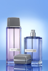Adam Levine fragrance bottles on a blue background