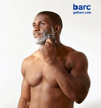 Reggie Bush shaving with shaving cream and a razor
