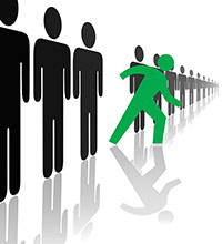 Figures at a start line, with a green figure ready to race ahead