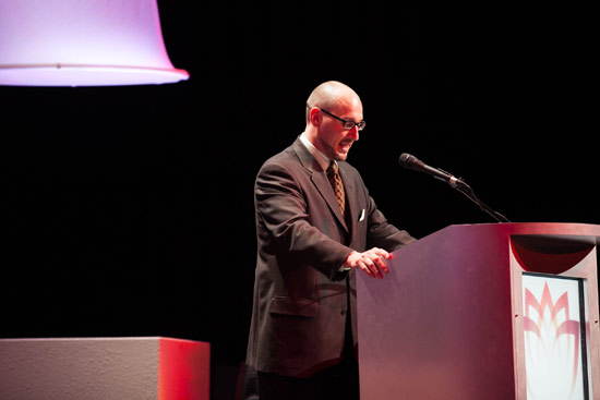 Jeff Falk moderates at a podium at WPC 2012