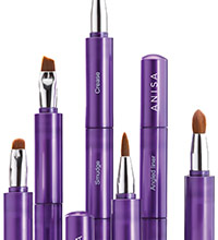 Purple makeup brushes, uncapped and with different tips, from Anisa International