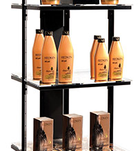 Retail display with shelves holding Redken hair care products