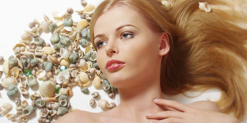 Blonde woman with seashells in hair