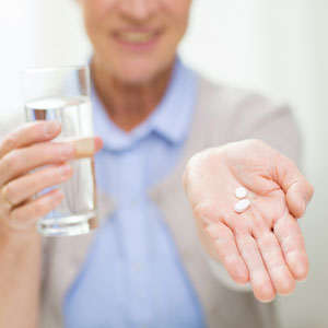 Senior-woman-with-pills-300