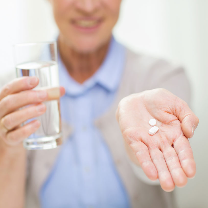 Senior-woman-with-pills