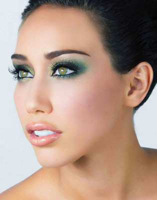 Green and gold accentuate the eyes of a model