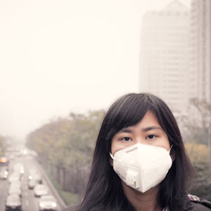 Woman in air pollution