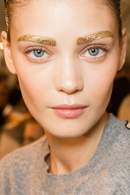 Model with gold brows