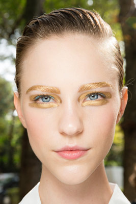 Model with gold eye makeup