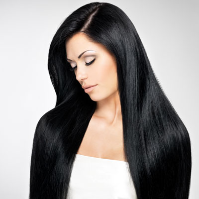 Woman looking down with long, strong, dark hair