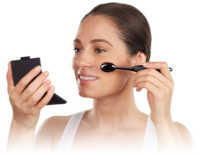 Model applies makeup with Artis makeup brush, available from Taiki