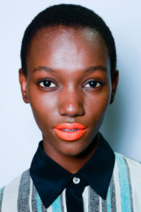 Model wearing orange lipstick