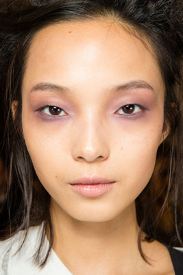 Model with purple eye makeup