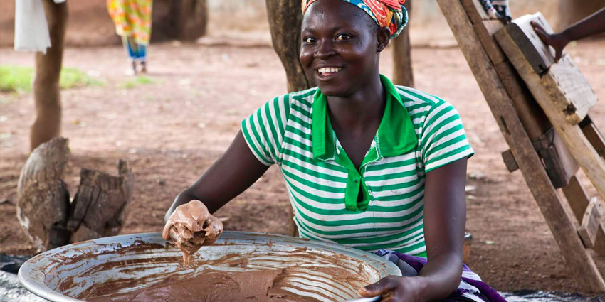 African woman working with shea