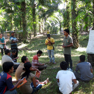 Trainer with his group in West Kalimantan